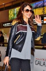 Olga Kurylenko - at Narita International Airport in Tokyo 5/6/13