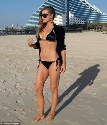 Carmen Electra - wearing a bikini in Dubai - Apr 2013