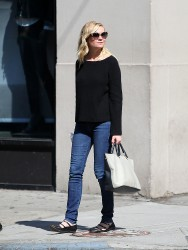 Kirsten Dunst buys a pair of emergency sunglasses while out shopping in New York